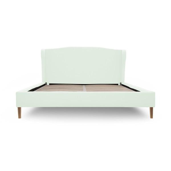 Pastelowo zielone łóżko z naturalnymi nóżkami Vivonita Windsor, 140x200 cm