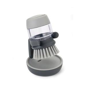 Szara szczotka do mycia naczyń z dozownikiem i stojakiem Joseph Joseph Palm Scrub