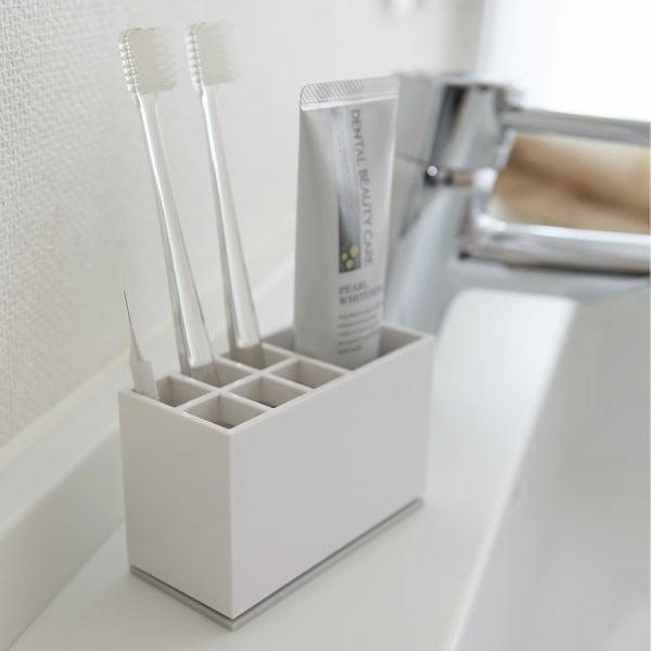 Biały pojemnik na szczoteczki i pastę do zębów YAMAZAKI Mist